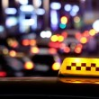 Illuminated traditional yellow taxi sign on top of a cab — Stock Video