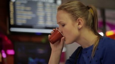 Young Woman Drinking Coffee — Stock Video