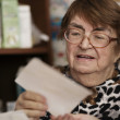 Elderly woman reading a letter — Fotografia Stock  #39582341