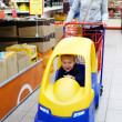 Child and mother in supermarket — Stock Photo #39582671
