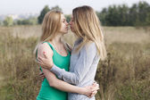 Two sisters or female friends in a close embrace — Stock Photo