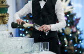 Waiter pouring glasses of champagne — Stock Photo