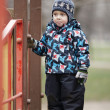 Cute little boy dressed in trendy winter clothes — Stock Photo