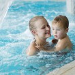 Mother and her son in the swimming pool. — Stock Photo