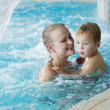 Mother and her son in the swimming pool. — Stock Photo #40530753