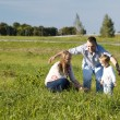 Protective father playing with his wife and son — Stock Photo #40531005