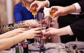 Group of people toasting at a celebration — Stock Photo