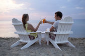 Romantic couple toasting the sunset — Stock Photo