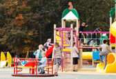 Children playing in an outdoor playground — Stock Photo