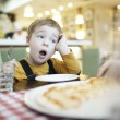 Young boy yawning as he waits to be fed — Stock Photo