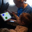Young mother and son traveling on an aeroplane — Stock Photo