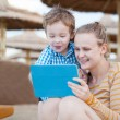 Happy mother and son at a beach resort — Stock Photo