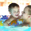 Mother and her son in the outdoor swimming pool — Stock Photo #43425091
