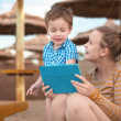 Little boy with is mother at a beach resort — Stock Photo #43425125
