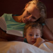 Mother reading a bedtime story to her little son — Stock Photo