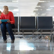 Young mother and son in an airport terminal — Stock Photo