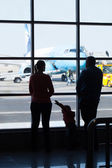 Young family watching planes at an airport — Stock Photo