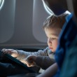 Little boy traveling in an airplane — Stock Photo #43539487