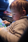 Little boy playing on a tablet computer — Stock Photo