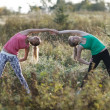 Two supple young women working out together — Stock Photo #43541097
