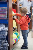 Cute little boy shopping for a beach accessories — Stock Photo
