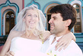 Happy laughing bride and groom — Stock Photo
