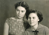 Vintage portrait of two attractive women — Stock Photo