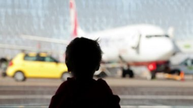 Little boy watching planes at the airport — Stock Video