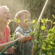 Mother and her young son playing with water — Stock Photo #48781679