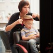 Little boy getting a haircut from hairdresser — Stock Photo #48781967
