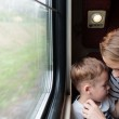 Mother and son on a train trip — Stock Photo #48782217