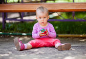 Small baby playing with toy — Stockfoto