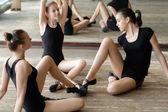 Three ballet dancers on the floor — Stock Photo
