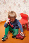 Young boy using red phone — Stock Photo