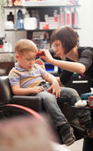 Little boy at the hairdresser — Stock Photo