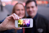 Happy couple taking self portrait — Stock Photo