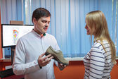 Woman consulting foot doctor — Stock Photo