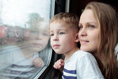 Mother and son looking through a train window — Stock Photo