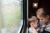 Mother and son on a train trip — Stock Photo