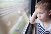 Boy looking out the window of train — Stock Photo