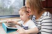 Mother and her young son on a train — Stock Photo