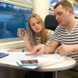 Young people working with plan in the train — Stock Video #49128239