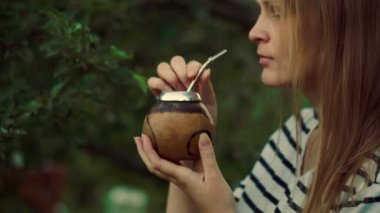 Young woman drinking mate — Stock Video