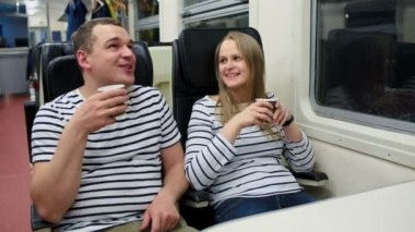 Man and woman drinking tea in the train — Stock Video