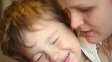 Mother dandling her little son — Stock Video