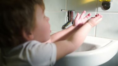 Boy washing hands with soft soap — Stock Video