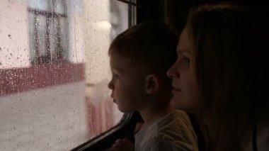 Mother and son in the train looking out the window — Stock Video