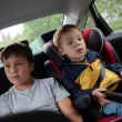 Children sitting in the car and looking at the road — Stock Photo