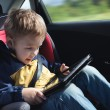 Child in the car with tablet PC — Stock Photo #49209089