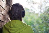 Woman listening to music outdoor — Stock Photo
